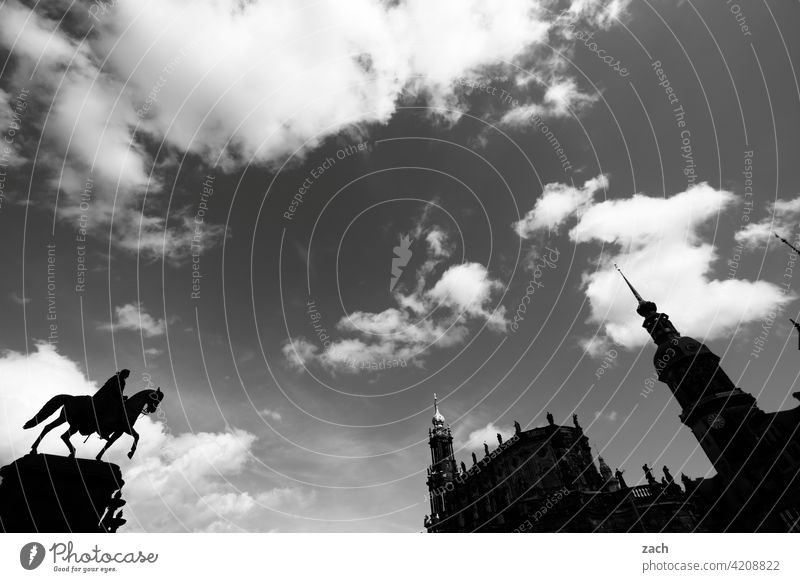 Dresden in silhouette Dresden Old Town Saxony Ride Rider Equestrian statue Old town Tower Lock Church Church spire Black & white photo Sky Clouds