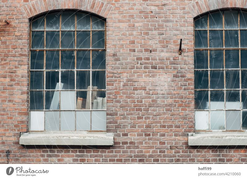 Two windows of a warehouse with red clinker and closed windows Warehouse Gloomy waiting zone 50s Harbour Logistics logistics Hall Flake Storage Industry