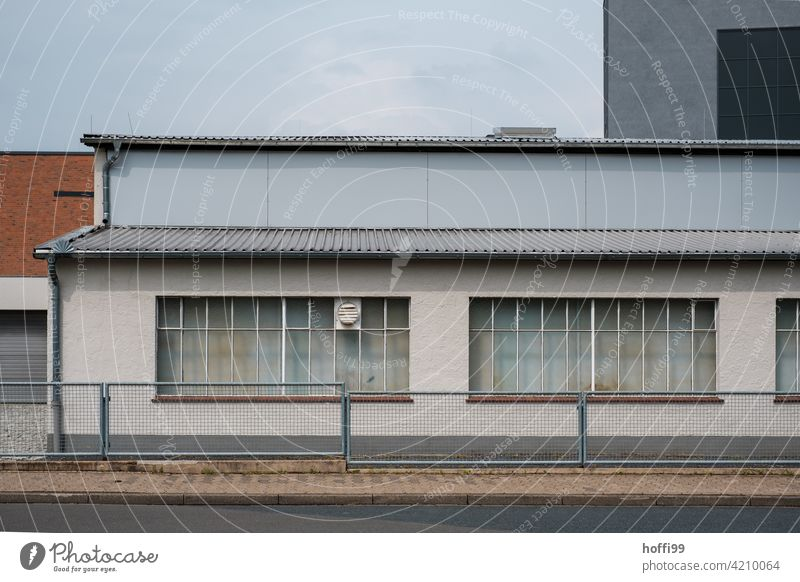 Warehouse with fence and closed windows Gloomy waiting zone 50s Harbour Logistics logistics Hall Flake Storage Industry Building Facade Industrial plant