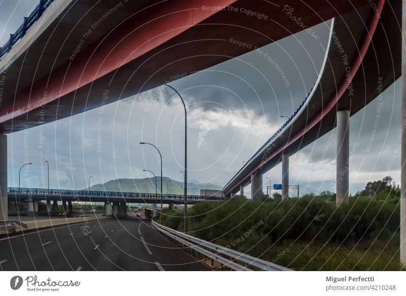 Several bridges at a highway junction with a cloudy sky. road architecture malaga infrastructures viaduct transportation overpass travel traffic city concrete