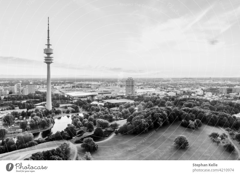 Aerial view over the beautiful bavarian town Munich, monaco, with its popular tourism hotspot at the Olympic park and its the high tower at a bright day. sun
