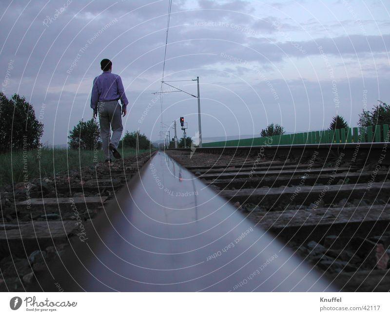 walk away Hiking Loneliness Railroad tracks Photographic technology Human being Walking