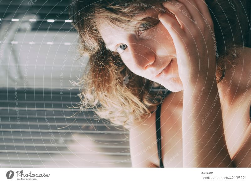 young woman with blue eyes and short hair inside her house adult caucasian ethnicity casual clothing beauty one woman only black built structure pattern