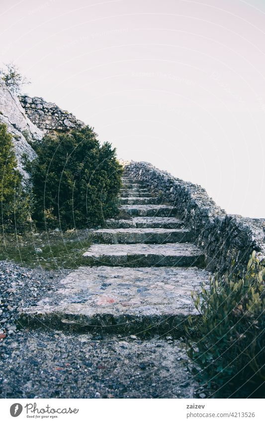 elongated stone stairs that ascend to the sky ladder path steps walk climb pathway staircase road age development direction follow guidance guide harmony