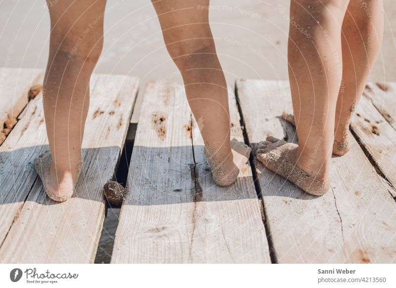 Children standing on the jetty by the sea children Infancy Playing Family Happy Joy Colour photo Exterior shot Happiness Nature Together Beach Footbridge Water