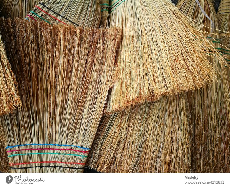 Traditional handmade brooms at a bazaar in Adapazari in the province of Sakarya in Turkey Broom sweeper straw broom Handcrafts Sweep polish Cleaning Straw