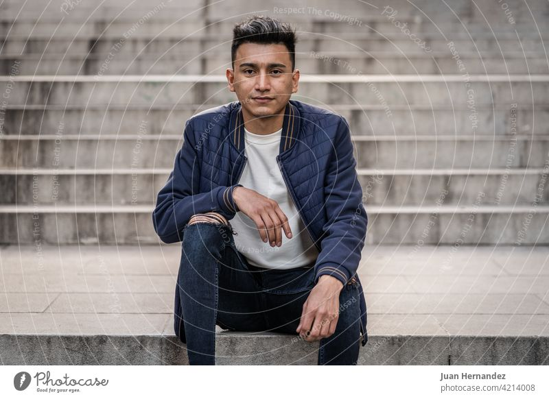 Hispanic man wearing jeans and casual jacket young hispanic guy latin latino expression handsome one person cool model photography looking at camera friendly