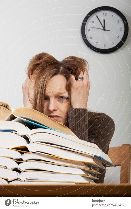 Student with books and watch University & College student Clock Book Girl Education Stress Alarm Desk test tired work teenager Table feminine School Fatigue