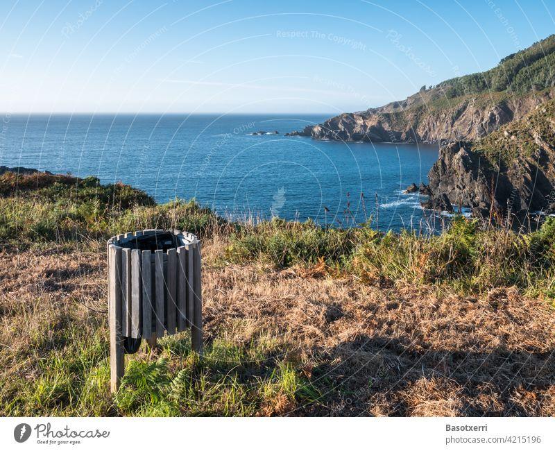 The best trash can in the world. Sunset on the Atlantic coast near Cedeira, Rías Altas, Galicia, Spain. litter bins Wastepaper basket waste Throw away Trash