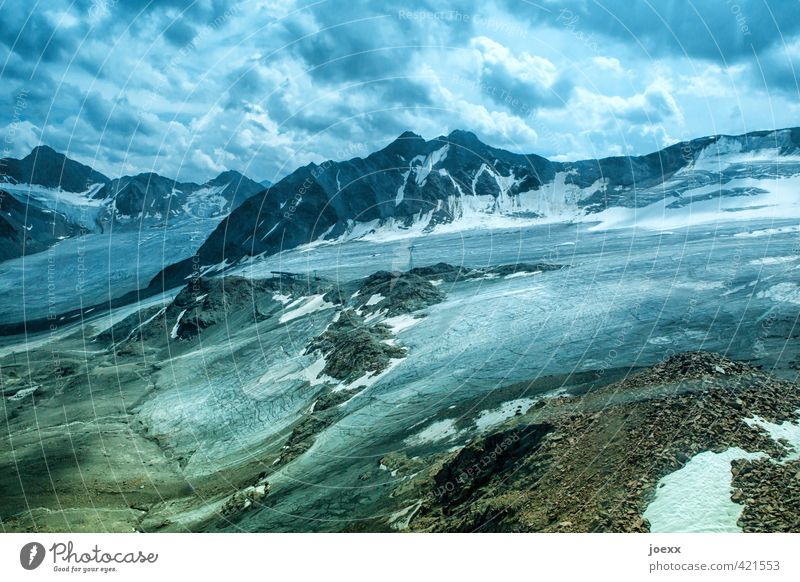 glacier ice Landscape Sky Clouds Climate change Bad weather Ice Frost Snow Alps Mountain Peak Glacier Gigantic Large Tall Blue Brown Green Black White Cold