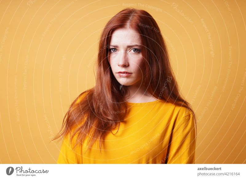sad young woman looking worried and depressed unhappy concerned worry person nervous anxious depression people girl female portrait caucasian adult casual lady