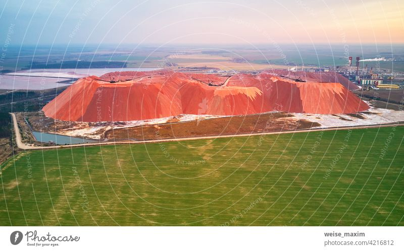 Extracting mining potassium, magnesium salts minerals. Large excavator machine, mountains of waste ore. Belarus, Soligorsk potash industry sodium fertilizer
