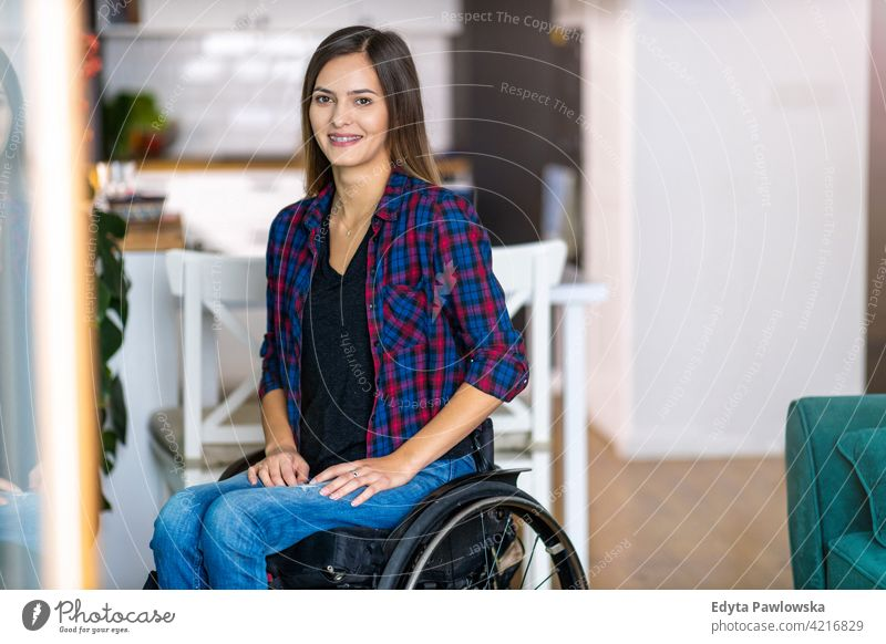 Young Woman In Wheelchair In Her Home wheelchair domestic life disability disabled confidence woman independent indoors home house people young adult casual