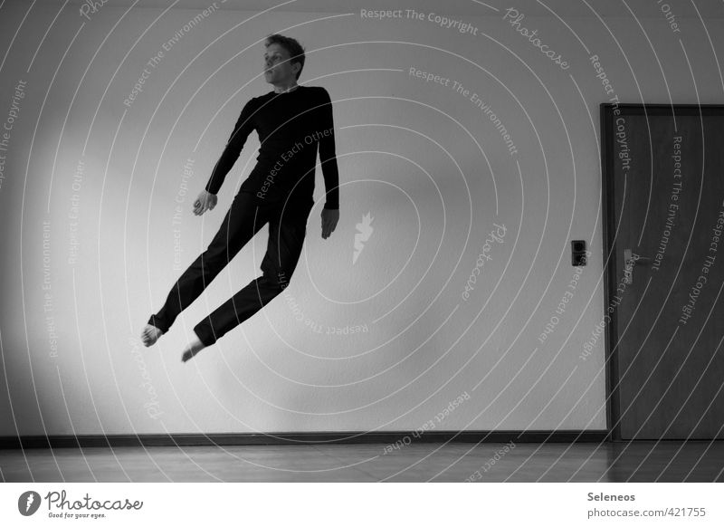 free flight Living or residing Flat (apartment) Room Human being Masculine Man Adults 1 Wall (barrier) Wall (building) Flying Weightlessness Black & white photo