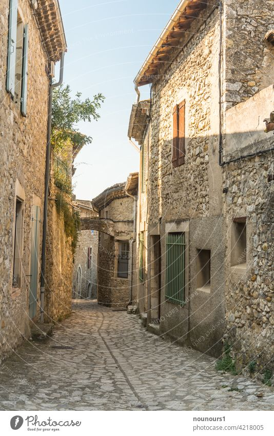 Alley in an old french village Street Traffic infrastructure Shadow Cobblestones Colour photo Paving stone Deserted Exterior shot Stone Lanes & trails Light