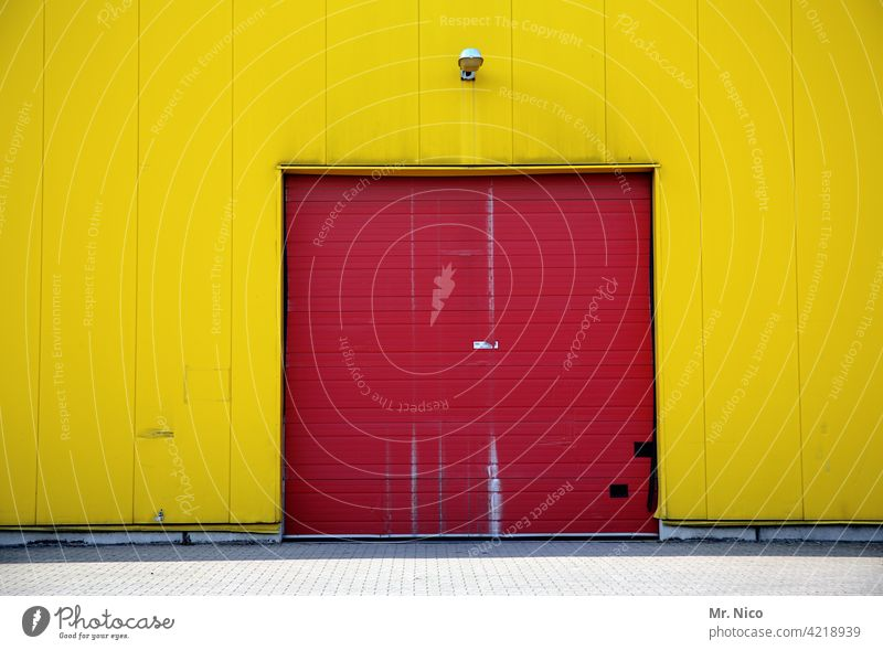 Two-coloured Red Yellow Building Goal Facade Wall (building) Warehouse Depot Trade Workplace Closed Rolling door Stock of merchandise Corrugated sheet iron