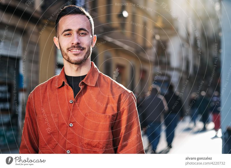 Man standing outdoors on the street. che portrait urban city confidence people one face smiling posing town smile looking outside confident style person male