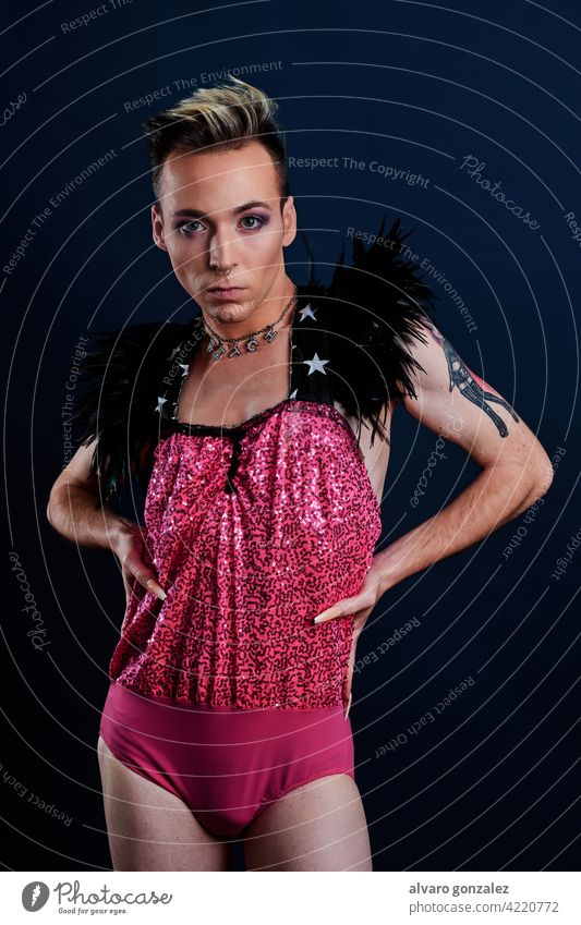 young transgender model with pink dress and dark blue background che homosexual diversity feminine portrait guy make-up male person caucasian isolated white