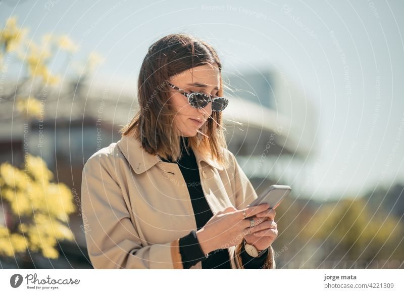 Portrait of a young businesswoman with her smart phone in lyon, france. person female caucasian europa lifestyle outdoors entrepreneur cyberspace freelancer