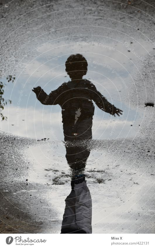 Human being Child Water Joy Dark Emotions Autumn Playing Laughter Swimming & Bathing Weather Rain Dirty Infancy Walking Happiness