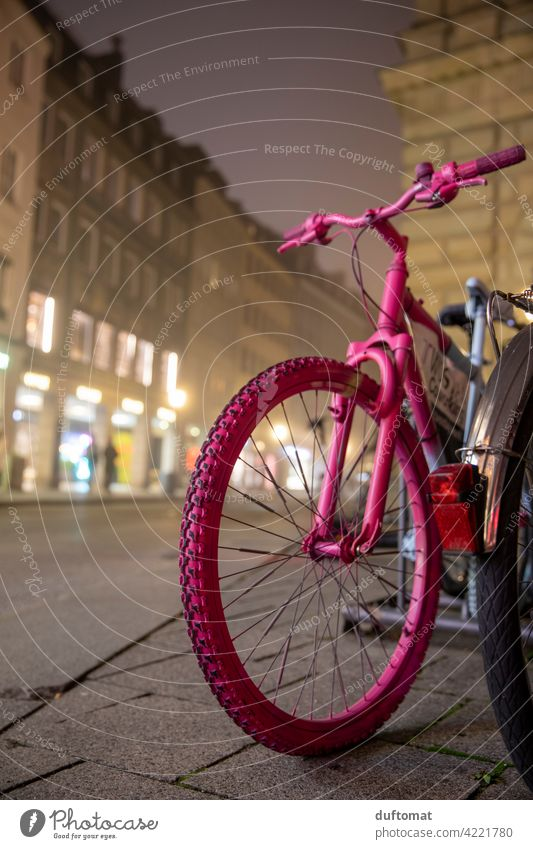 Pink bike in downtown fog Bicycle Wheel Spokes Tire Exterior shot Means of transport Deserted Transport Metal Parking Cycling Mobility Movement