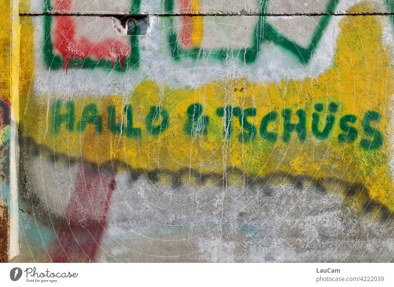 Hello & Bye in green on yellow Hello and bye Salutation Farewell Colour photo Green Communicate Welcome Characters Exterior shot Graffiti words Yellow Word