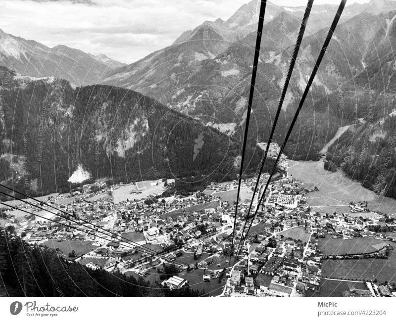 high up Cable car Vantage point View into the valley depth Fear of heights Rope Steel outlook Mountain Nature Valley Wire cable Panorama (View) Mayrhofen