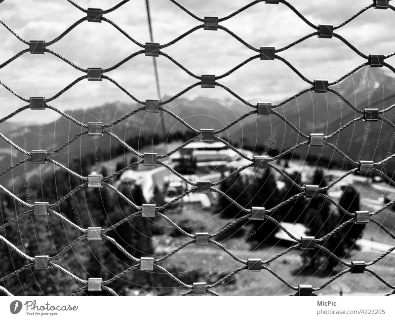 behind bars Fence do not jump onlooker Grating latticed Wire netting fence meshes Rope Cable car gondola Vantage point Safety Barrier Protection Exterior shot