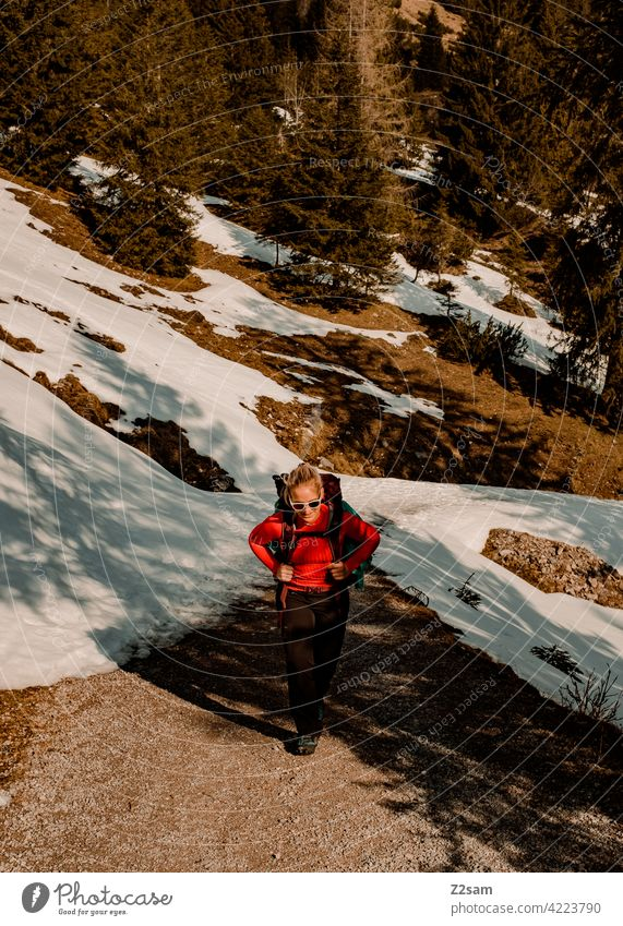 Young woman hiking on the Hochmiesing | Soinsee closeness to nature outdoor Hiking bavarian cell Upper Bavaria Alps mountains Spring Peak Sky Clouds warm colors