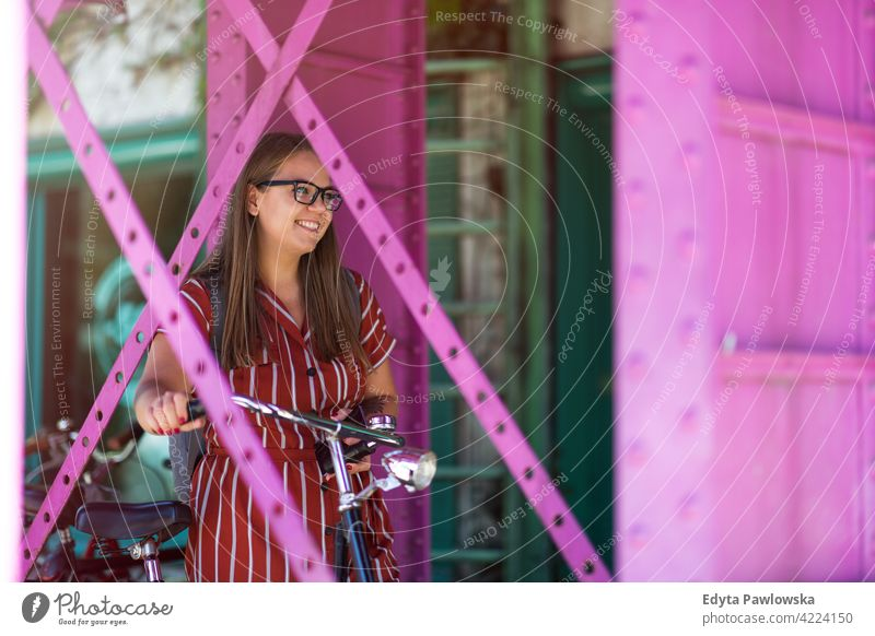 Happy young woman with bike in the city body positive Overweight Plus Size Model urban active people young adult casual attractive female happy Caucasian