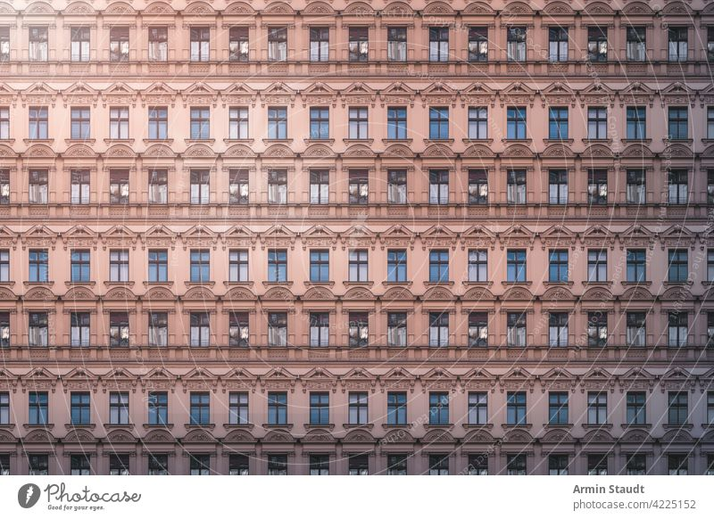architecture pattern, beautiful old building facade with stucco seamless repetition big huge anonymous mega city future modern overpopulation house rent rental