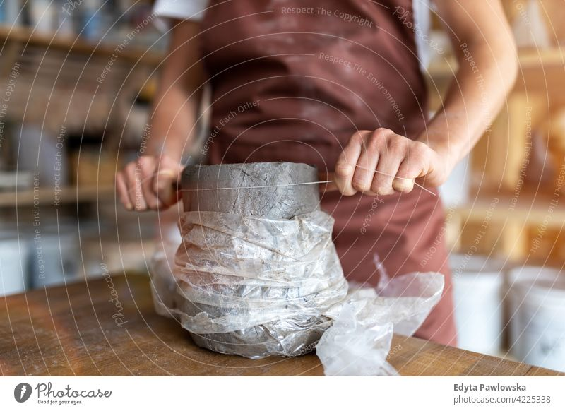 Woman pottery artist makes ceramics from clay work working people woman young adult casual attractive female happy Caucasian enjoying one person beautiful