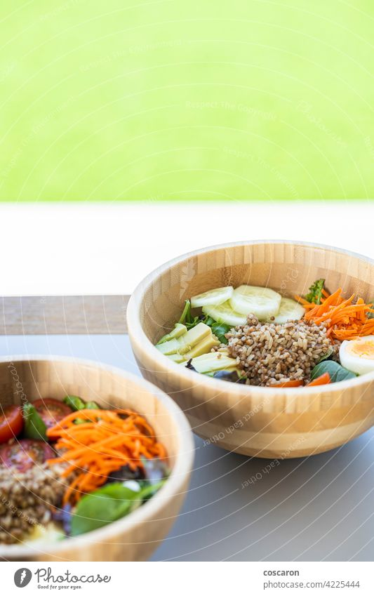 Brown rice salad with carrot, egg, cucumber, avocado, tomato and lamb's lettuce antioxidant asian background bowl brown buddha bowl copy space cuisine detox