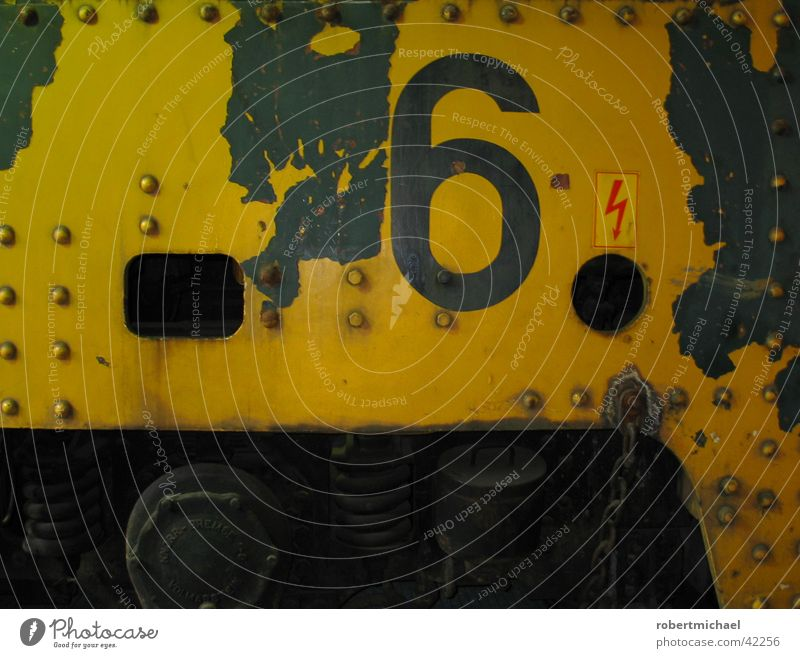 Number Six. Railroad Driving Typography Red Yellow Stencil Engines Vehicle Wall (building) Rust Route 66 Digits and numbers Electricity Lightning Steel Iron