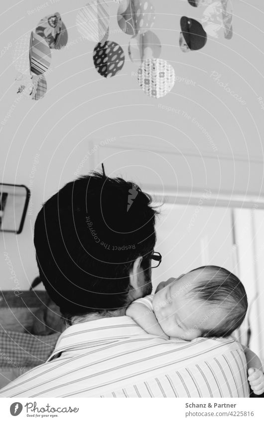 Daddy with baby in his arms fallen asleep dad Baby Toddler fall asleep Parents Become a dad parental leave Daddy and child Father Paternity Mobile