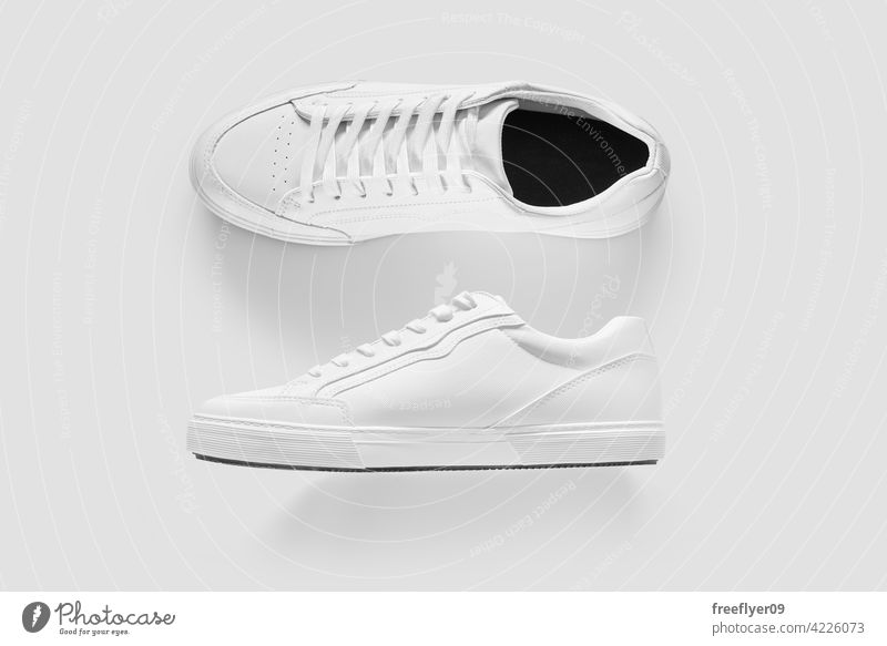 Mockup of the side and top of white generic sneakers mockup apparel isolated copy space shoes footwear e-commerce ecommerce basic white background object still