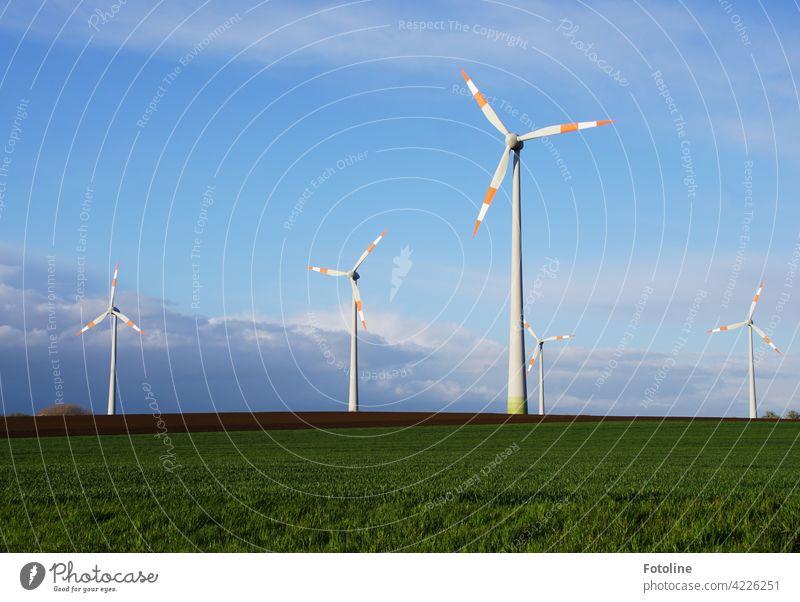 Wind energy is generated here. Wind turbines turn against a cloudy sky. Pinwheel Wind energy plant Energy Renewable energy Energy industry Electricity Sky