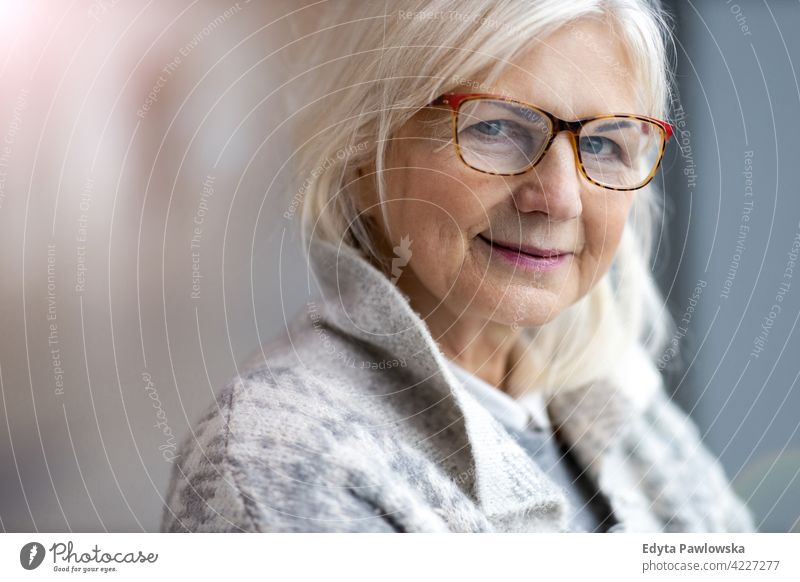 Portrait of senior woman wearing glasses eyeglasses happy smiling enjoying relaxed positivity confident natural seniors pensioner pensioners casual outdoors