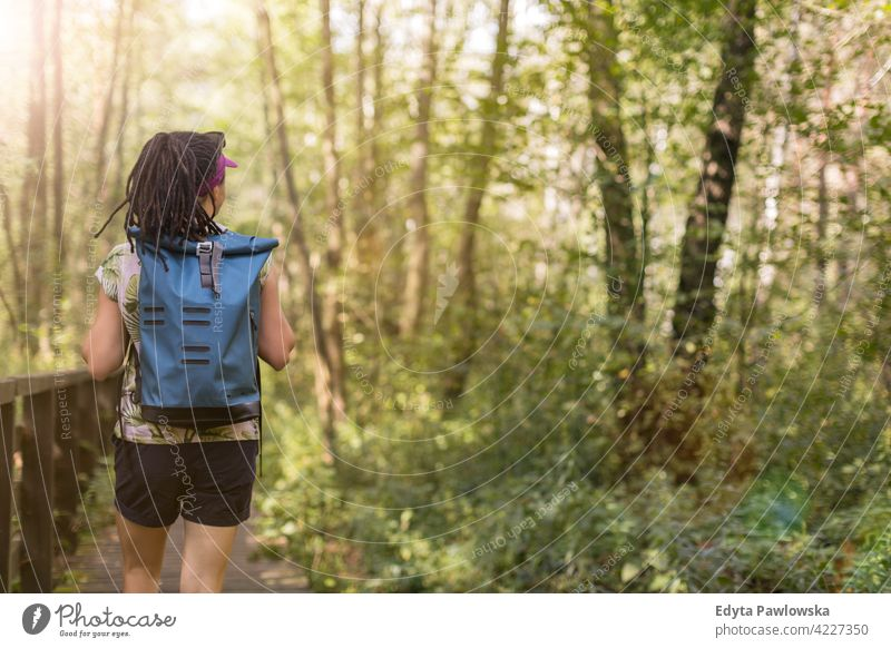 Young woman hiking in the forest summer nature wild green people outdoors one person happy Caucasian wilderness plant tree Poland day tranquility daytime