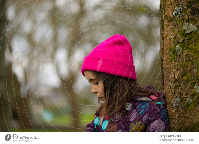 close-up Caucasian girl standing up With casual clothes and a pink hat. In a natural park. beautiful beauty casual clothing caucasian caucasian ethnicity child