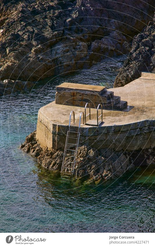 trampoline and staircase on an artificial beach directly to the ocean in Ireland tramore rock pool peaceful landscape waterford cove south east ireland vacation