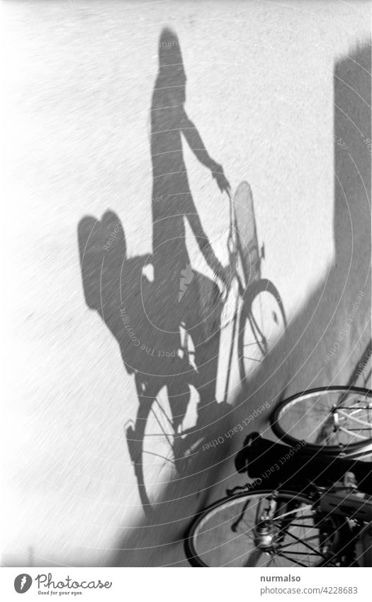 Cycling in the shade. Bicycle Child Mother Shadow Cycle path swift ecological co2 Child seat Shopping Trip Parents Family