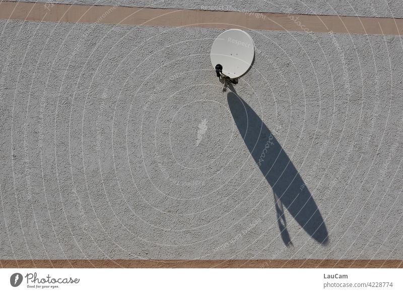 Small satellite dish with big shadow play Satellite Dish Shadow Shadow play Facade house facade Sun Sunlight shadow cast Large communication television Receive