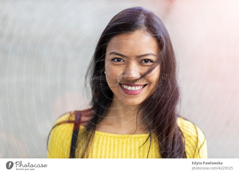 Portrait of beautiful young woman in urban area Filipino street city active people young adult casual attractive female happy asian enjoying one person