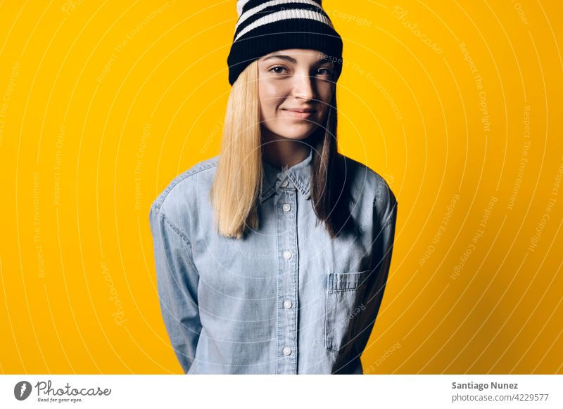 Happy Girl Wearing Hat Portrait smile smiling cute innocence cheerful happy happiness studio yellow background portrait looking at camera expression colorful