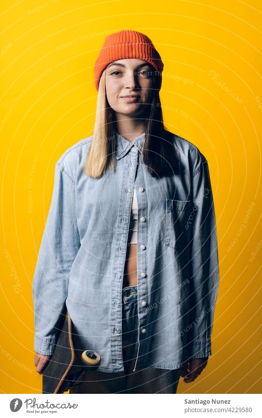 Cool Young Girl Portrait studio yellow background portrait looking at camera expression colorful hair style casual young girl female serious two colors hair