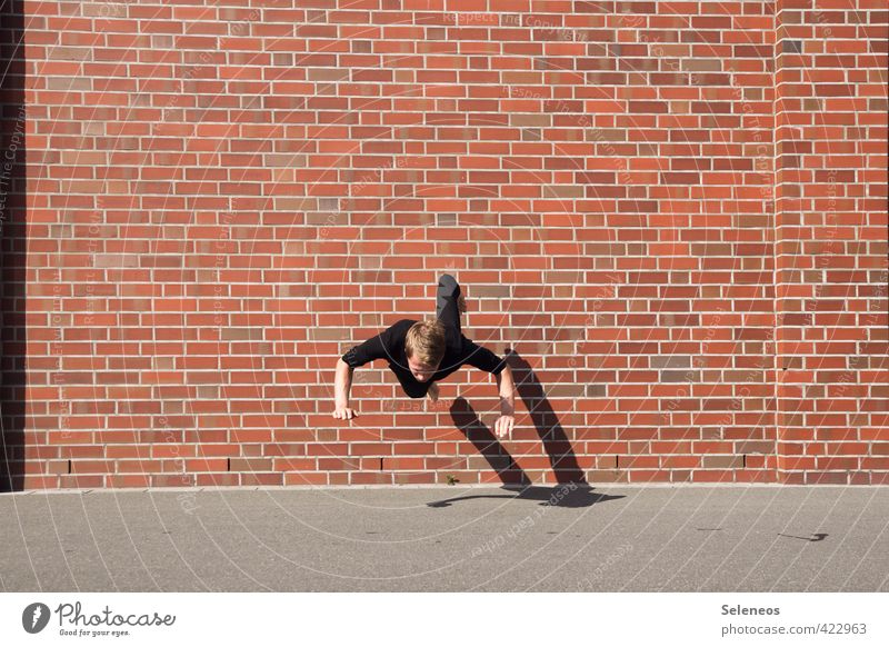 Human being Man Summer Sun Adults Wall (building) Sports Wall (barrier) Jump Masculine Facade To fall Athletic Brick