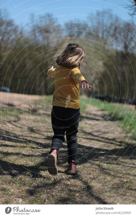 Girl running on a dirt road Running Romp Playing Flying Dream Field Meadow off the beaten track Nature be out Spring Arable land Edge of the forest