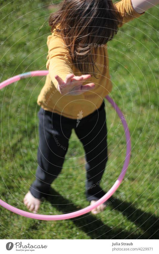 Hands up in the hula hoop Girl Infancy Child Nursery school child Kindergarten Playing being out Hula hoop Hands up! yeah turns Circle circling Round Pink