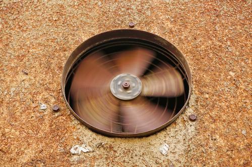 turning wheel of an old rusty wall fan in a rusty wall / physics / fan / rotation Wall fan Fan Rotate Wall (building) Old fan wheel integrated Exhaust air fan